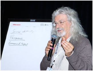 Co-convener of the Town Hall on Marine Debris, René Garello, discussing some results.  (Photo courtesy of Rick A. Smith)