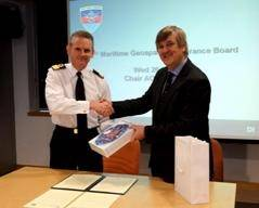 Commodore Guy Robinson from Navy Command Headquarters shaking hands with Geraint West, the NOC's Director of National Marine Facilities after the signing of the Memorandum of Understanding