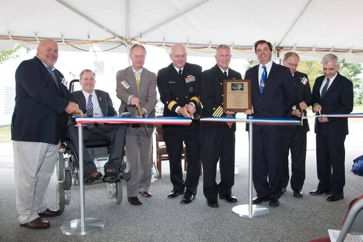 Cutting the ribbon, from left, Dominic Galluci, P&S Construction; RI Congressman James Langevin; RI Governor Lincoln Chafee; Rear Adm. Michael Jabaley, commander, NUWC; Capt. Todd Cramer, commander, NUWC Division Newport; Mark Rodrigues, head NUWC's Platform and Payload Integration Department; Blair Decker, General Dynamics/Electric Boat; and RI Senator Jack Reed.