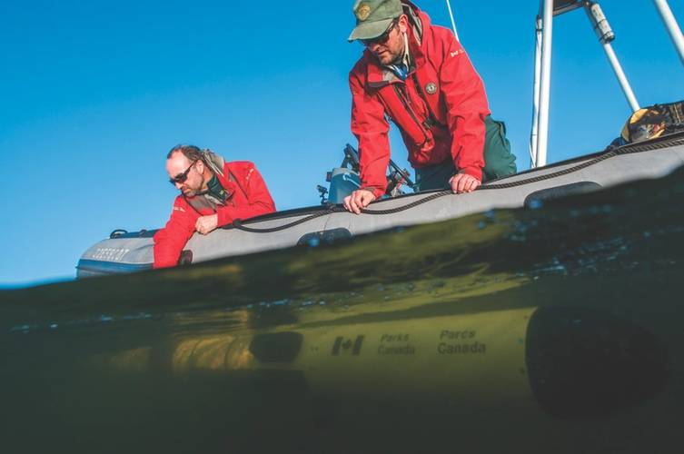 Deployement of Iver 3 - 312 AUV by Marc-André Bernier and Ryan Harris (Photo: Thierry Boyer, Parks Canada)