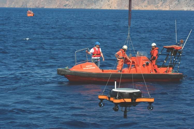 USV deployment with AUV in parking position. (Photo courtesy: Javier Gilabert)