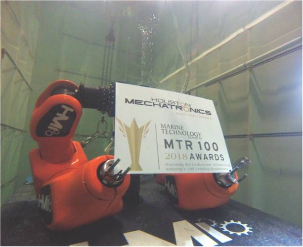 "MTR does not present an ""MTR100 Creative Photo"" award, but if we did this year's winner is Houston Mechatronics. Pictured is Houston Mechatronic's Aquanaut in wet testing earlier this year holding it's MTR100 'trophy'. (Photo: Houston Mechatronics)"