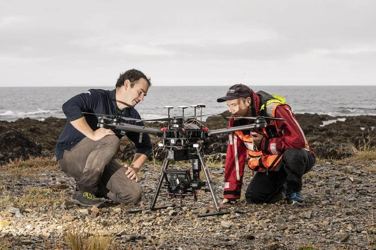 Drone pilot Hamish Sutton (left) and Dr Leigh Tait check settings before launching another pre-programmed flight across the Taputeranga Marine Reserve. © Rebekah Parsons-King, NIWA