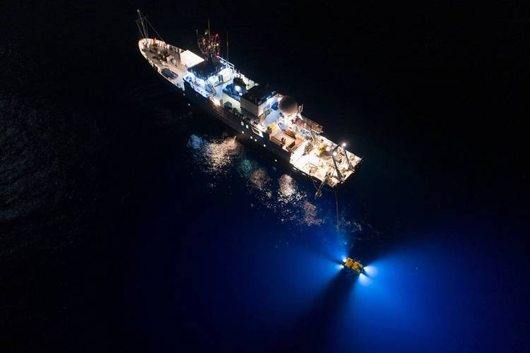 Drones filming from above reveal Hercules as it scours the ocean floor day and night for any sign of the famous aviator who disappeared in 1937. (Rob Lyall/National Geographic Image Collection)