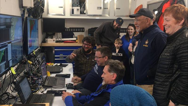 The expedition team hosted visitors to the mission control van to see ASV BEN mapping unfold in real time. (Photo: Ocean Exploration Trust)