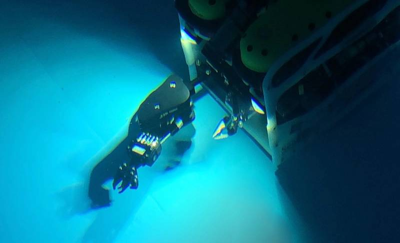 Falcon fitted with multi-function manipulator in test tank.  (Photo by Collin Dobson, Woods Hole Oceanographic Institution)