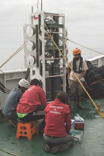 Figure 6: Chilean marine scientists collect samples from the benthic lander Audacia after its third trip to the trench floor, reaching 8081m. (Image: Courtesy Kevin Hardy and Atacamex 2018)