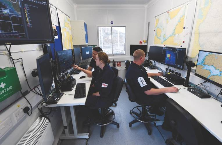 Figure 2: Mission Control at Unmanned Warrior. Each Royal Navy operator is monitoring a Neptune squad of multiple robots. (U.S. Navy photo by John F. Williams)