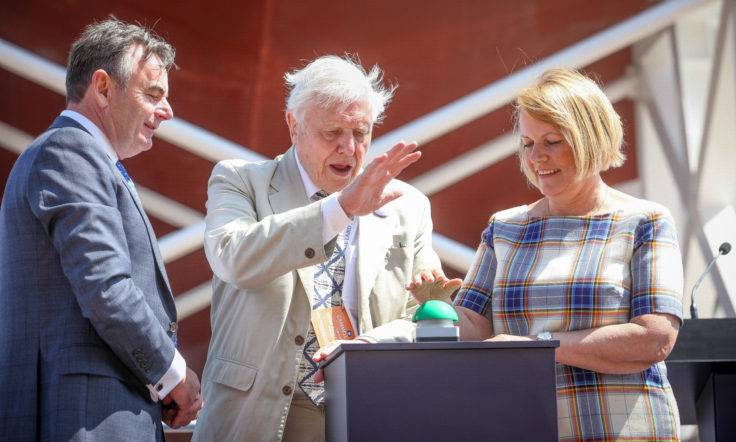 From left to right: Cammel Laird Chief Executive John Syvret watches Sir David Attenborough and BAS Director Prof Dame Jane Francis push the launch button. (Photo: Simon Williams-Tully)