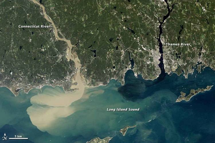 Full of rainwater from Hurricane Irene, which drenched New England in August 2011, the Connecticut River sent large amounts of muddy sediment into Long Island Sound. (Photo: NASA Earth Observatory)