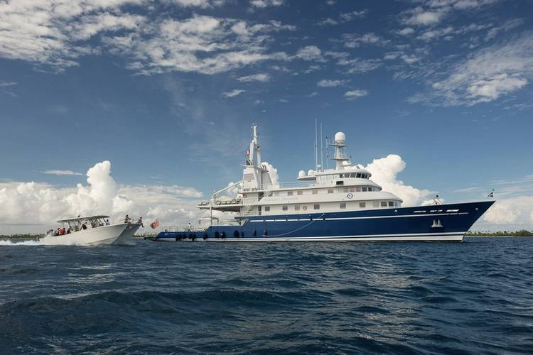 M/Y Golden Shadow with dive vessel, the Calcutta. © Michele Westmorland /iLCP