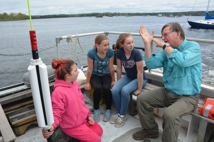 Graham explains to Islesboro, ME students how the Sea Rocket works. © Isleboro Central School