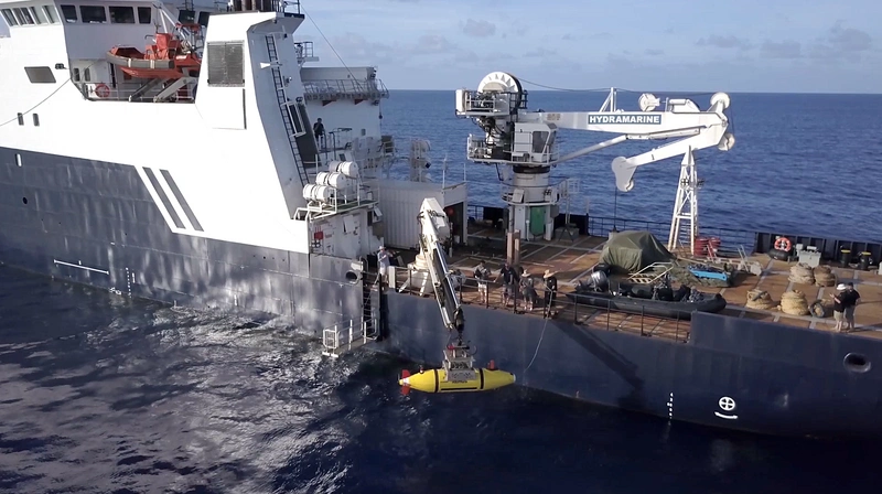 The AUV Hydroid Remus 6000 is deployed from the R/V Petrel in search of the USS Indianapolis. (Photo courtesy of Paul G. Allen)