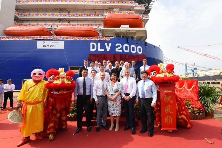 Leaders from McDermott International and Keppel are joined by the vessel's lady sponsor and celebrants during the naming ceremony of the DLV 2000, a high-specification deepwater derrick lay vessel at the Keppel Singmarine Shipyard. (Photo: McDermott)