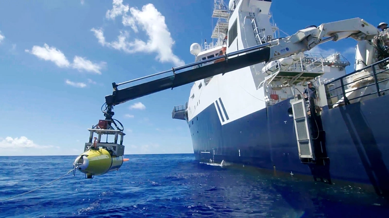 The AUV is lowered into the Philippine Sea in search of the USS Indianapolis. (Photo courtesy of Paul G. Allen)