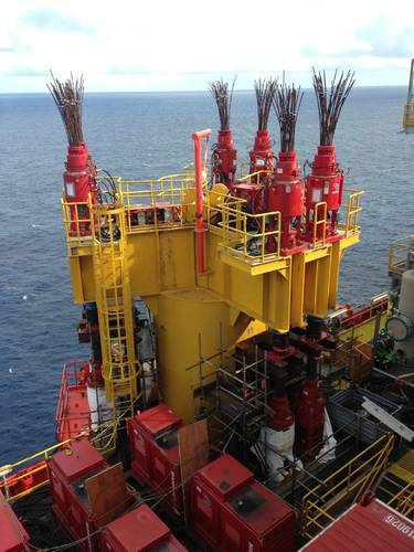 Mammoet strand jacks and power packs installed on the platform legs. (Photo: Mammoet)