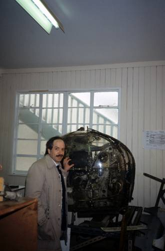 Marty Klein with a section of the Wellington Bomber that he helped to find in Loch Ness in 1976. (courtesy Martin Klein and the MIT Museum)
