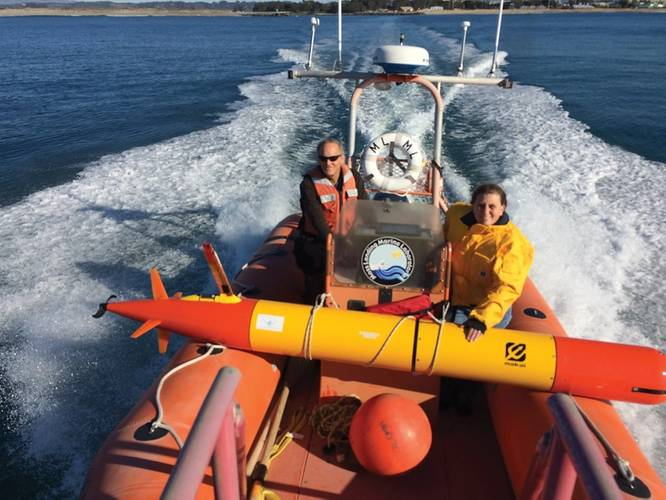MBARI researchers head out into Monterey Bay to deploy a long-range autonomous underwater vehicle (LR-AUV), an underwater robot that is programmed at the surface and then travels underwater for hundreds of miles, measuring water chemistry and collecting water samples as it goes.  Credit: Brian Kieft (c) 2015 MBARI