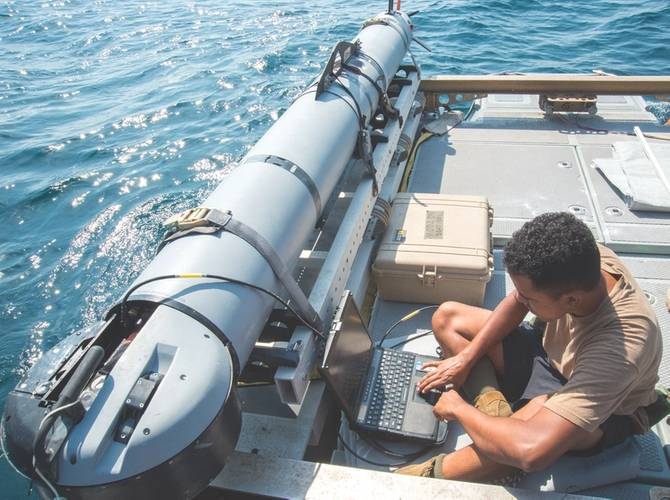 Mineman 3rd Class John Stephen-Torres, Commander, Task Group (CTG) 56.1, observes data from a MK 18 MOD 2 UUV for a training evolution during a mine countermeasures squadron exercise (SQUADEX) aboard the Bay-class landing dock ship Cardigan Bay (L3009) of the Royal Fleet Auxiliary. CTG 56.1 conducts mine countermeasures, explosive ordnance disposal, salvage-diving, and force protection operations throughout the U.S. 5th Fleet area of operations. (U.S. Navy photo by Jonah Stepanik)