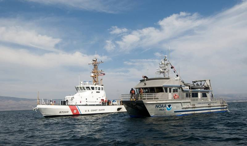 NOAA R/V Shearwater (right) and USCG Cutter Halibut (left) conduct remotely operated vehicle (ROV) operations over the USCG Cutter McCulloch shipwreck site. (Credit: Robert V. Schwemmer NOAA)