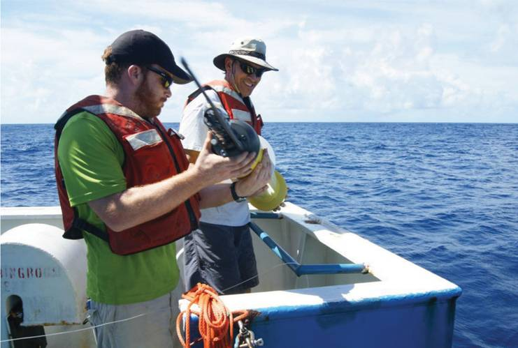 Patrick Berk and Rick Cole deploy an Argo float from BJ3.
