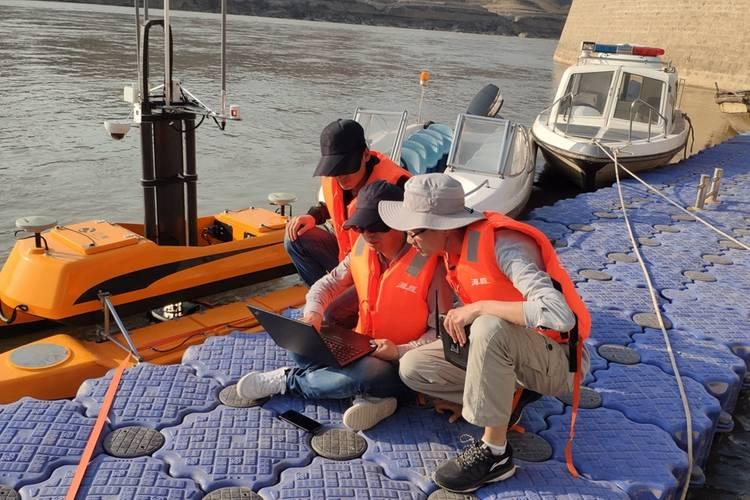 Personnel install and debug equipment at the dock. Image: OceanAlpha