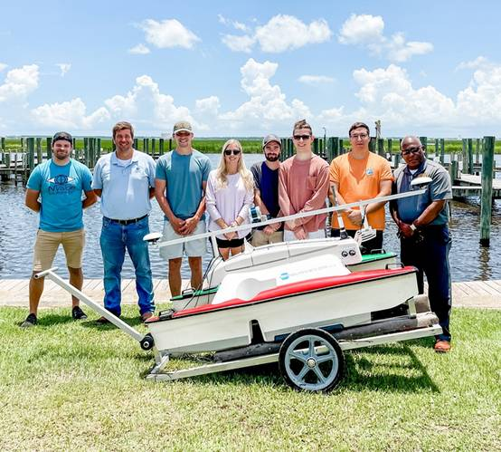 Pictured Left to right: Ryan Dodd, - Hydrographer, NVision Solutions, Inc.   Associate Professor, NOARC; Joel Lawhead – Vice President, Nvision Solutions, Inc. Associate Professor, NOARC; PRCC Students: Caleb Spence, Heather Dinger, Wesley Parker, Alex Moon, Billy Snowden; and Raymunda Barnes- Assistant Vice President, PRCC. Photo courtesy NOARC