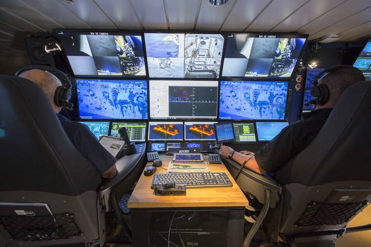 ROV pilots aboard RV Petrel. Greensea's OPENSEA enabled the use of synchronized pilot and co-pilot chairs. (Photo courtesy of Paul G. Allen)
