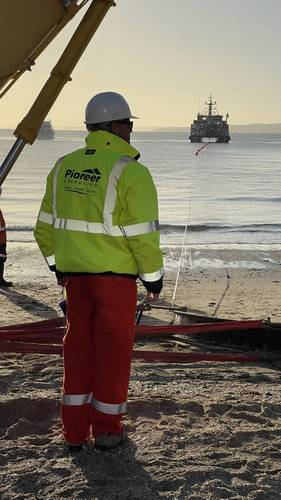 Pioneer Consulting team member oversees the landing of subsea cable. Credit: Pioneer Consulting.