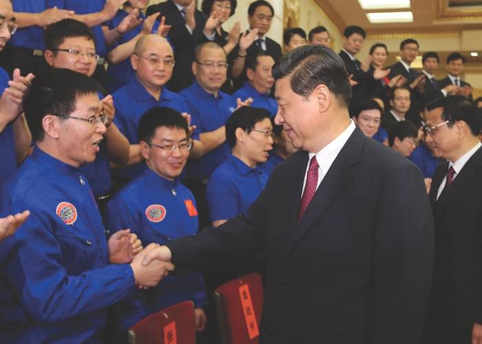 "Professor Cui Weicheng receiving the title ""National Hero of China,"" from PRC President Xi Jinping, following his successful dives to over 7,000m in the submersible Jiaolong. (Image: Professor Cui Weicheng, Shanghai Ocean University)"