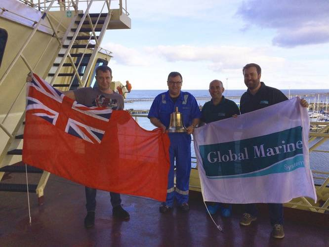 Re-flagging of the vessel from the Danish Marine Agency to the UK Marine Coastguard Agency. L-R: 2nd Officer, Maersk; Captain Flemming Bang, Maersk; Captain Richard Kearns, Master CS Recorder, Global Marine; and Rob Twell, Marine Manager for Global Marine (Photo: Global Marine Systems Limited)
