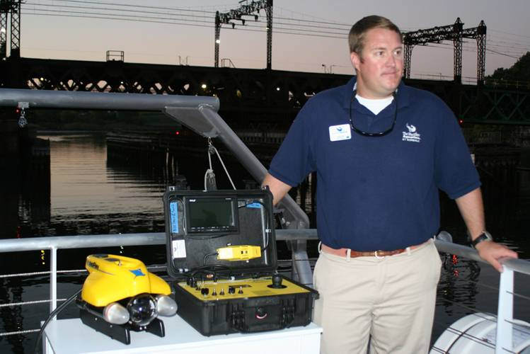 New research vessel for The Maritime Aquarium at Norwalk comes with a VideoRay ROV equipped with cameras that will allow students to explore the bottom of Long Island Sound, shipwrecks in the Sound and more. Shown with Aquarium Educator Colin Thom.