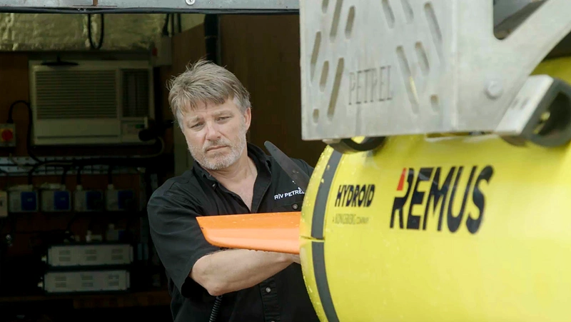 Robert Kraft, Director, Subsea Ops at Vulcan, prepares to deploy the AUV in search of the USS Indianapolis. (Photo courtesy of Paul G. Allen)