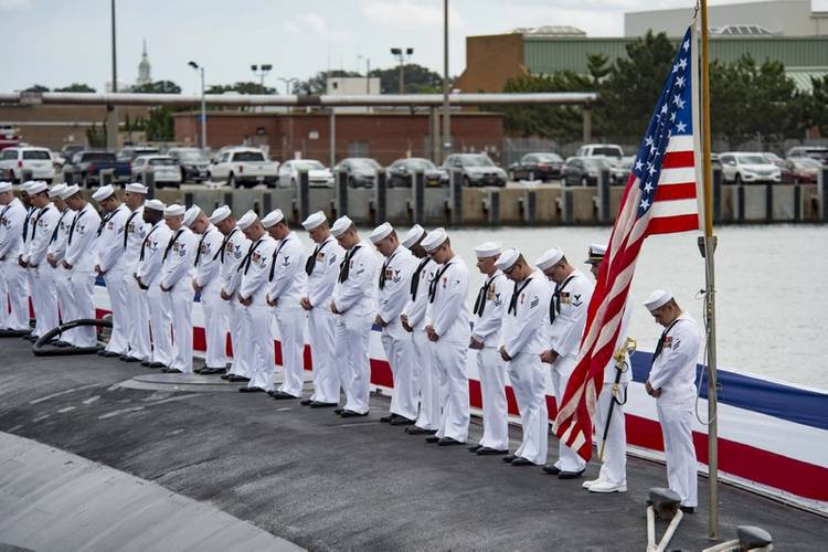Sailors render a salute during the commissioning ceremony for the Virginia Class Submarine USS Washington (SSN 787) at Naval Station Norfolk. (U.S. Navy photo by Patrick T. Bauer)