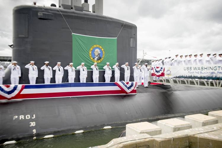 Sailors render a salute during the commissioning ceremony for the Virginia Class Submarine USS Washington (SSN 787) at Naval Station Norfolk. Washington is the U.S. Navy's 14th Virginia-class attack submarine and the fourth U.S. Navy ship named for the State of Washington. (U.S. Navy photo by Class Joshua M. Tolbert)