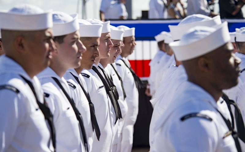 Sailors stand in formation, waiting to bring the ship to life, during the commissioning ceremony for the Virginia-class attack submarine USS Washington (SSN 787) at Naval Station Norfolk. (U.S. Navy photo by Patrick T. Bauer)