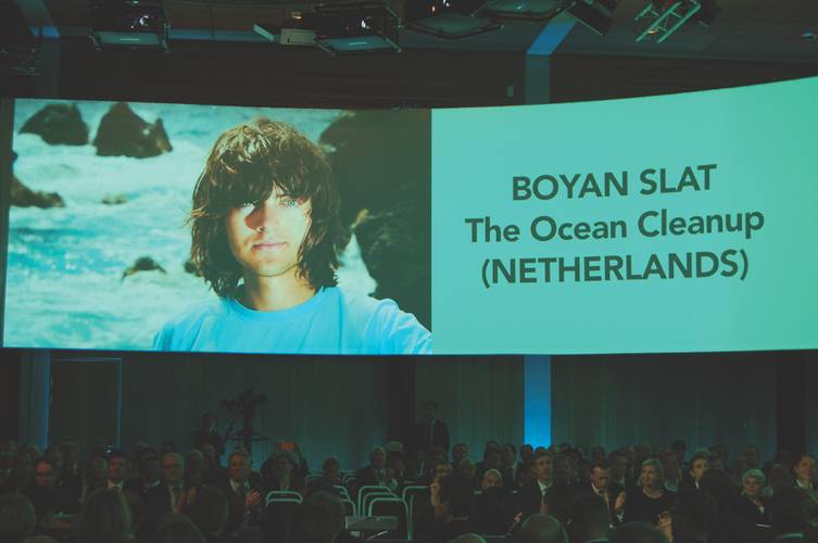 Big screen banner: Ocean Clean-Up CEO Boyan Slat above a captivated Nor-Shipping 2015 audience.