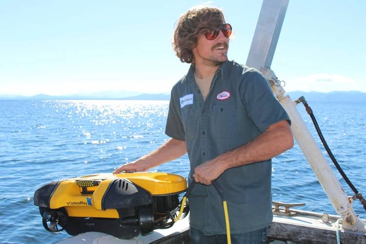 Senior engineer and product development lead, Colin Riggs, launches the Mission Specialist one-man portable ROV in Vermont. (Photo: Greensea)