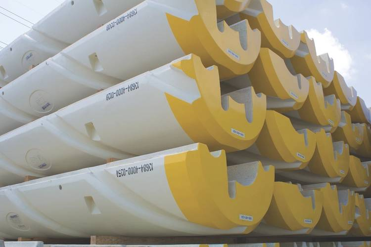 Stacked drill riser buoyancy modules integrated with inverted helical grooves. (Image: Trelleborg)