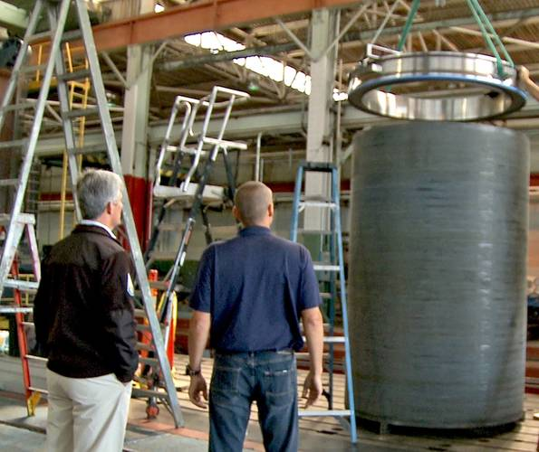 Stockton Rush, OceanGate CEO, and Tony Nissen, Director of Engineering supervise the assembly of a titanium ring on the carbon fiber wound cylinder (Photo: OceanGate)