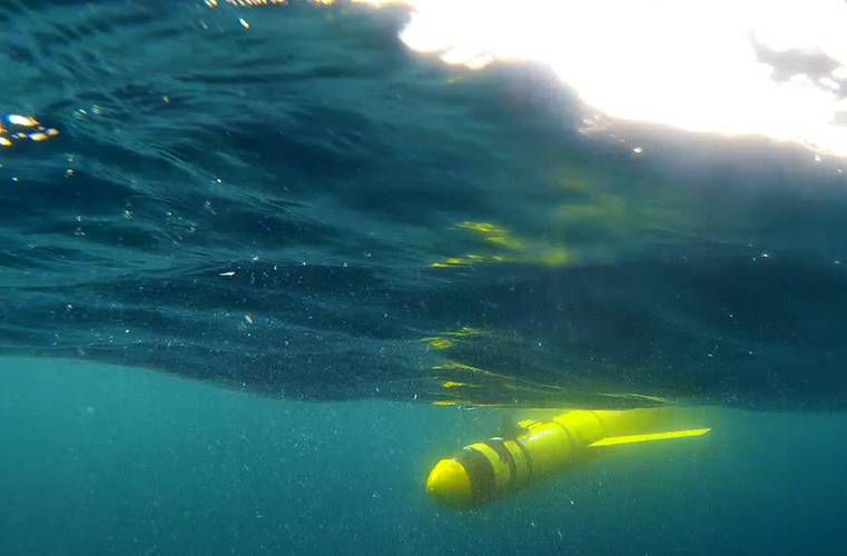 A submarine glider, owned by Blue Ocean Monitoring, prepares for its first dive after being deployed off Orkney (Photo: NOC)