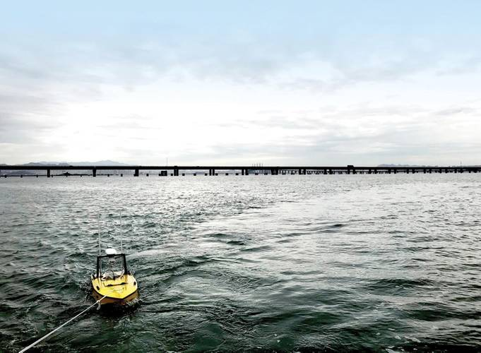 Testing the USV's systems in a bay near Qingdao, China. The test includes boat stability (by hauling/dragging the vehicle) and communication quality. Photo: Nortek