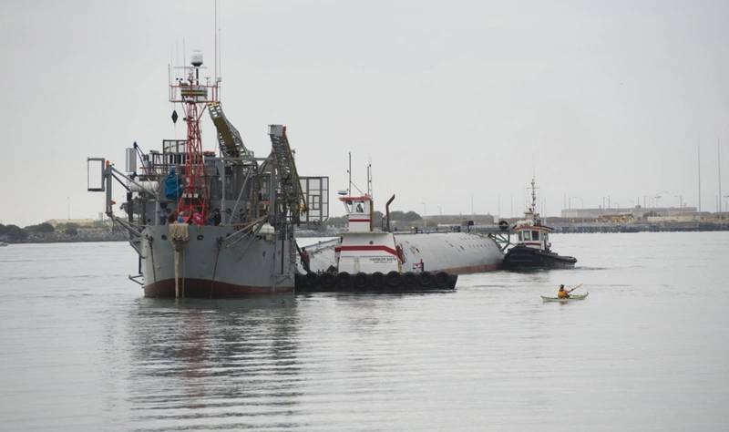 Tugs guide the Department of the Navy's Floating Instrument Platform (FLIP) from her berth at the Nimitz Marine Facility in Point Loma, Calif. (U.S. Navy photo by John F. Williams/Released)