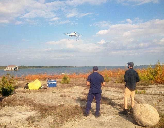 An Unmanned Aircraft System (UAS) takes off from Thunder Bay Island under the supervision of its pilots. (Image courtesy of Thunder Bay National Marine Sanctuary, NOAA)