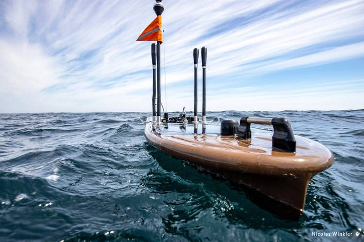 Wave Gliders float on the ocean's surface. They are emission-free, propelled by wave energy, and solar powered. The glider collects oceanographic and weather data and can offload animal detection data from acoustic receivers without the need to bring them to the surface. © Nicolas Winkler