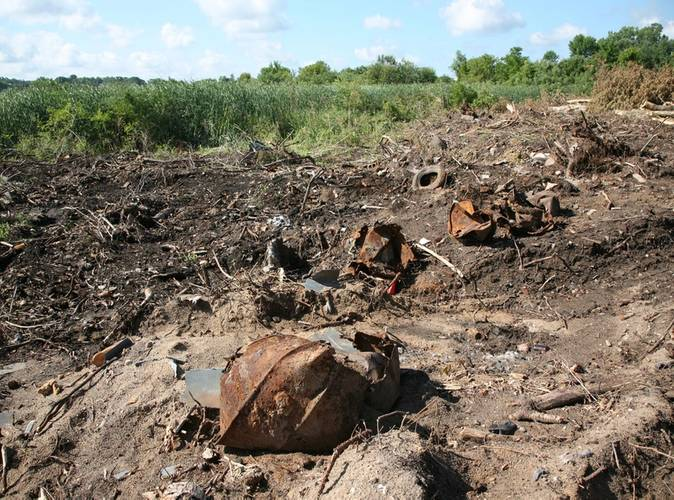 The White Lake Montague Dump site restoration was littered with rusty barrels, tires and other debris. (Photo: EPA)