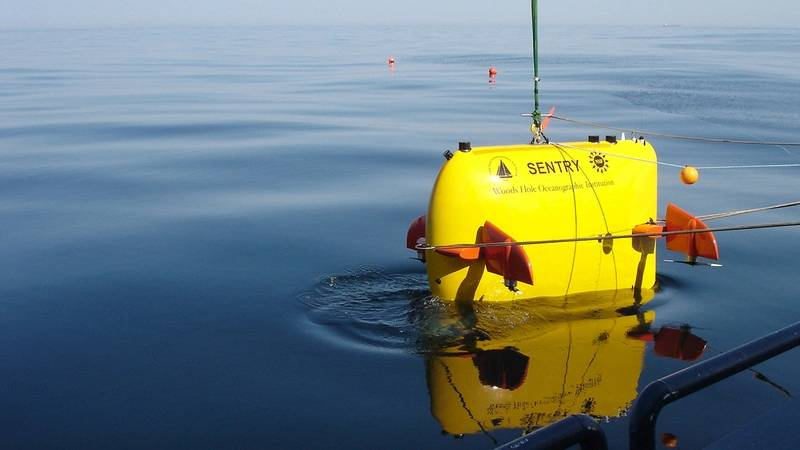 WHOI scientists used deep-sea vehicles, including Sentry, to locate the voyage data recorder (above) from the El Faro on the seafloor 15,000 feet deep. The VDR offers clues to understand why the ship tragically sank in 2015, killing 33 crew members aboard. (Photo: Chris German, Woods Hole Oceanographic Institution)